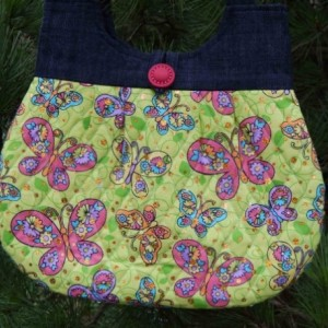 Lime and pink butterfly quilted hobo style handbag with denim top