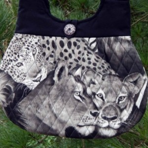 Lions and cheetahs quilted hobo style handbag