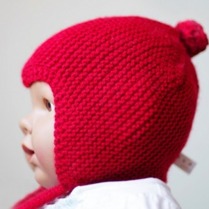 Red knitted baby pilot hat with ties