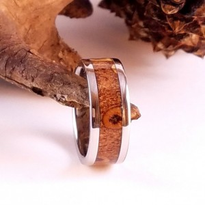 size 4 7/8 Pinecone ring around a Stainless steel core  with Stainless edges, 9mm wide band