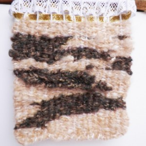 A Hand-Woven Wall Hanging on Tree Bark