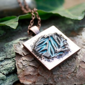 Hand-stamped copper pendant with light blue leaf imprint