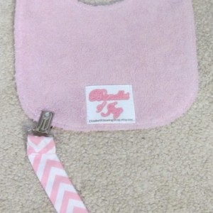 Baby Bib with pacifier or toy hook, pink and blue chevron, removable tether, multi-use bib