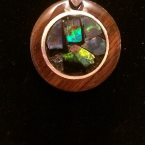 Mosaic opal necklace set in Arizona iron wood and copper.