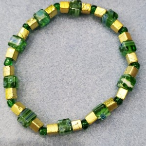 green milliflori and gold bracelet