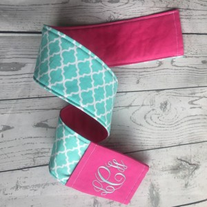 Camera strap cover- aqua quatrefoil with pink lens cap pocket