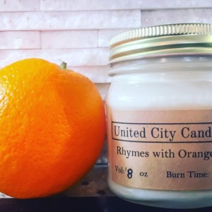 Rhymes with Orange No. 61 -- Florida citrus sunshine.  This candle bursts with Vitamin C. 100% soy candle. United City Candle Co Made in USA