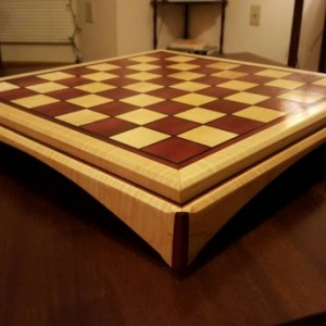 Chessboard made of purple heart and quilted maple with ebony inlays