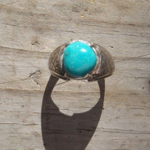 Sterling silver ring set with a turquoise stone.