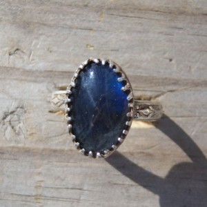 handcrafted sterling silver ring set with natural Labradorite cabochon. Ring was crafted and stone stet in the 1980's
