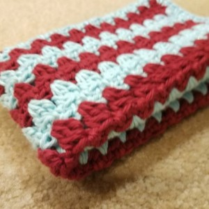 Handmade cotton hand towel.  Dish towel.  Drying mat. Made for the kitchen. Red and aqua