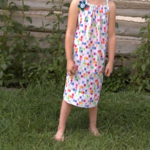 Upcycled pillowcase dress with removable flower