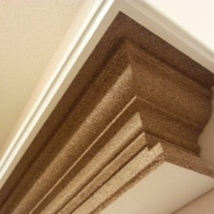Floating crown molding shelf with stone finish