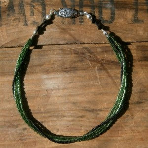 Jade green 3 strand anklet wrapped in black beads with black Swarovski crystals