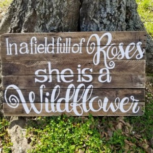 In a field full of roses she is a wildflower handpainted pallet sign, nursery decor, little girl room wall hanging art, rustic pallet art
