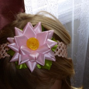 Baby/toddler light pink flower on stretchable peachy headband
