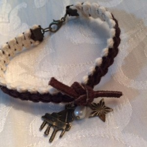 Simple ribbon bracelet with bronze tone piano, start, and pearl charms #B00226