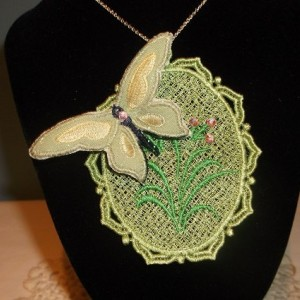 """Machine embroidered cameo necklace with 3-D butterfly. Pat attached her designs onto a 9"""" silver chain purchased from Hobby Lobby."""