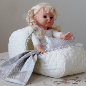 Pattern #4 Doll bassinet carrier of quilted cotton with a pillow and a blanket