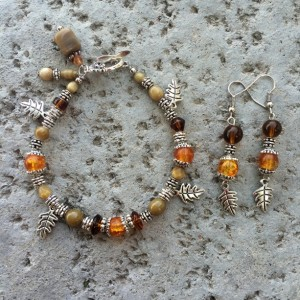 Silver-toned, brown and gold glass silver-toned spacers and leaf charm bracelet & earrings