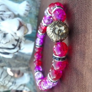 Red colored lion charmed braclet