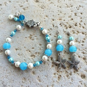 Silver-toned, turquoise and white glass pearl starfish charm bracelet & earrings