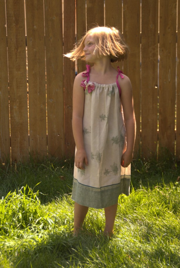 Upcycled pillowcase dress with removable butterfly