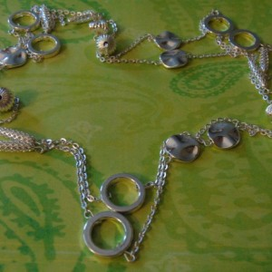 Various Silver Beads Linked With Chains