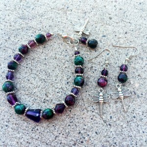 Semiprecious zoisite stones, glass, silver-toned spacers and dragonfly charm bracelet and earrings