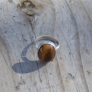 Tiger Eye cabochon set in handcrafted sterling silver ring.