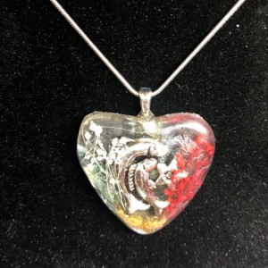 Zodiac sign pendant made with real baby breath , chameleon poder and feathers