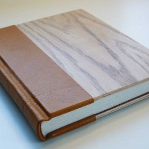 Hand-made book, bound in leather and wood.