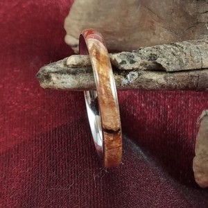 Size 9 burl and resin ring. The subtle colors of the resin compliment the burl around this stainless steel comfort core ring. 3mm band