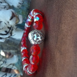 Ruby colored lion charmed braclet