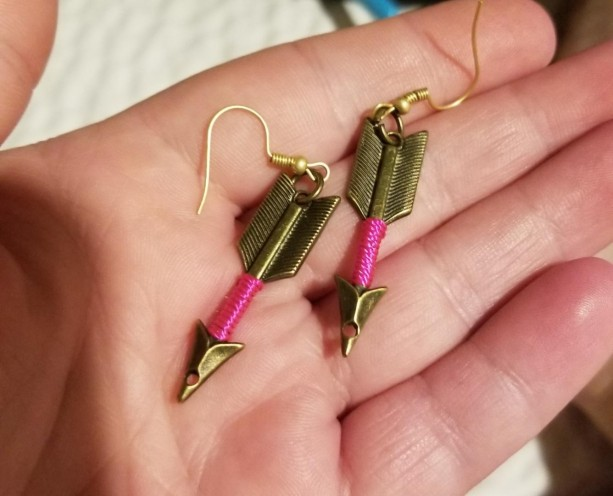 Gold arrow hook earrings with pink around arrow