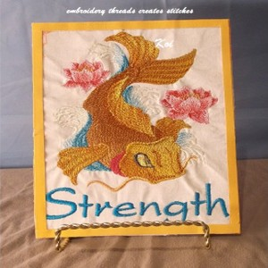 Machine embroidery placket of an ornamental Koi fish. The koi is brightly embroidered in gold threads.In Japan a symbol of Love Friendship.