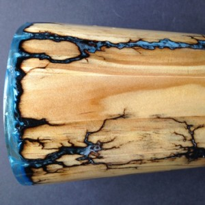 Wood vase with fractal Burns filled with blue pigment