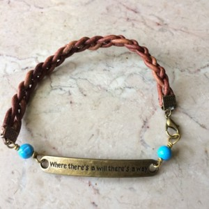 """Brown braided leather bracelet with bronze tone plate connector said """"Where there's a will there's a way""""& turquoise beads.# B00245"""