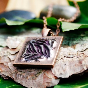 Dark purple leaves on copper pendant with necklace