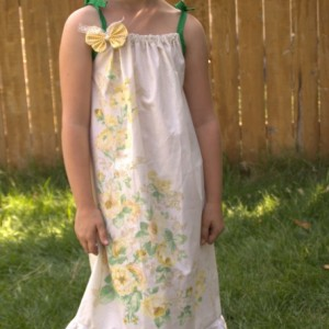Up-cycled pillowcase dress with removable butterfly