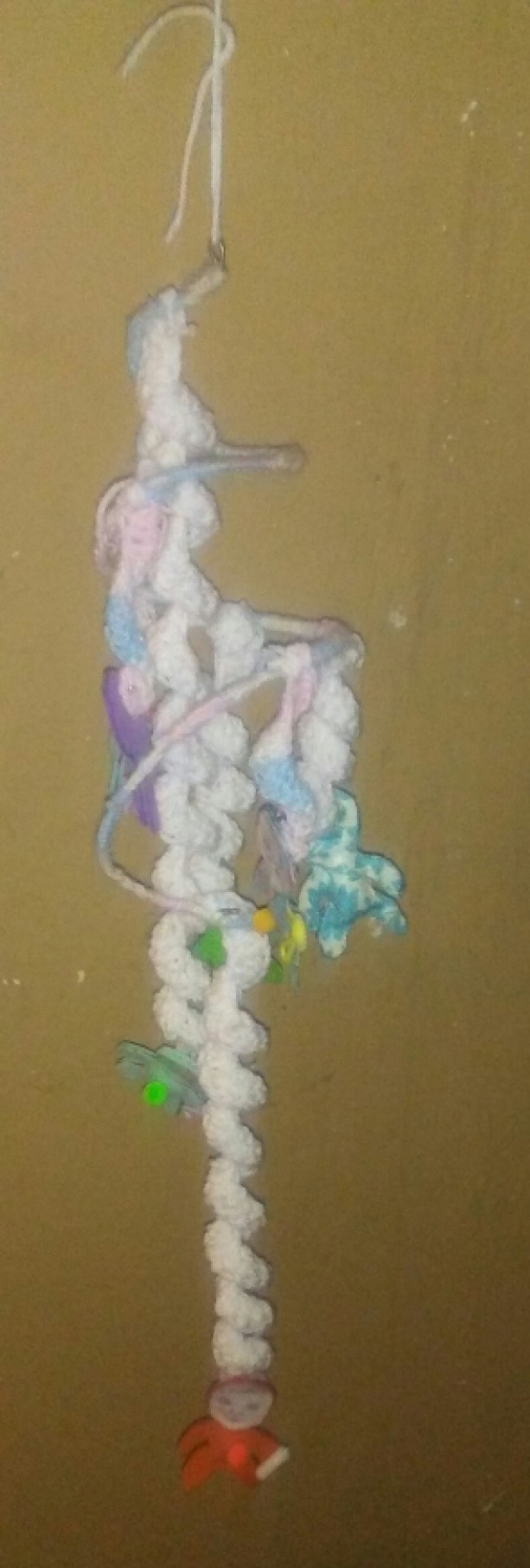 Crocheted mobile with felt babies attached.