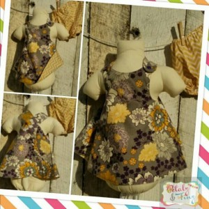Reversible dress and bloomers set. Grey with yellow and purple flowers.