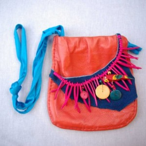 Hot tropical purse; made of leather with fruits to feed the tiny wild parrot