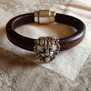 Unisex Regaliz leather bracelet with lion bead and German silver magnetic clasp.