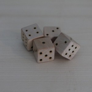 set of 4 Handmade Wooden Dice with wood burned numbers.