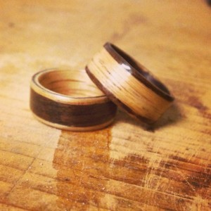 His and hers opposites Oak and Rosewood inlayed wedding band set
