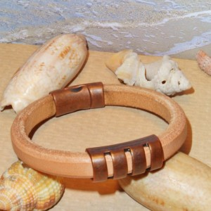 Natural Licorice Leather Bracelet accented with an antique copper colored split tube spacer bead and antique copper magnetic clasp.