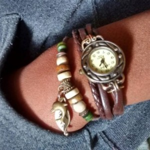 Faux leather boho bracelet style watch with leaf and dolphin charm- Roxanne