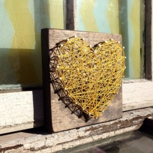 Nail and String Art Heart in Yellow on Stained Wood