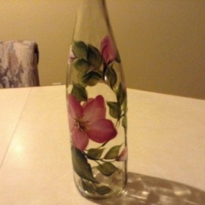 Handpainted oil dispenser with pretty pink wild roses and green leaves. Includes spout.
